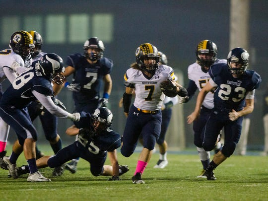 Northern's Theo Ellis (7) carries the ball away from players from Marysville during their game Oct. 7.