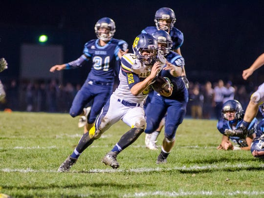 Algonac High School running back Jack Jewell runs the