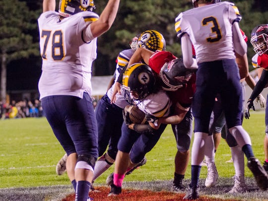 Port Huron Northern's Theo Ellis is brought down inside