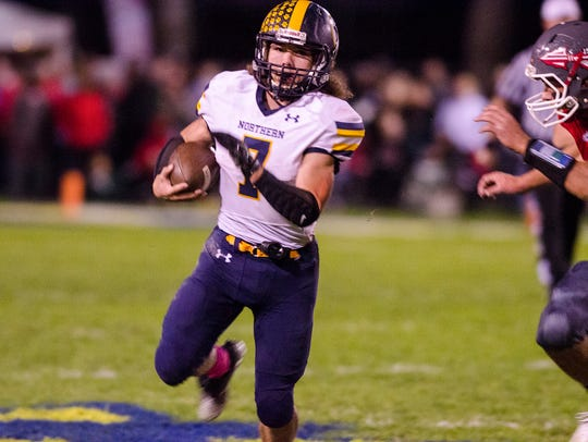 Port Huron Northern's Theo Ellis runs the ball during