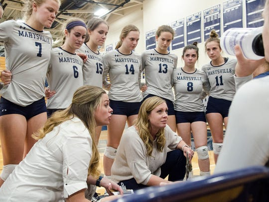 Marysville High School volleyball coaches Amanda Busch and Randi Kaufmann talk to the team during a timeout in the second game against Pontiac Notre-Dame High SChool in the MHSAA Class B Regional Semifinal volleyball game at North Branch HIgh School Nov. 7.