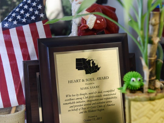 An award rests on a filing cabinet in Boys & Girls Clubs Director Mark Sakry's office in St. Cloud.