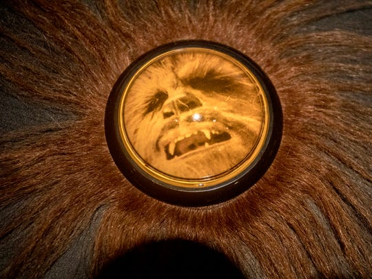 A Chewbacca button allows visitors to listen to his