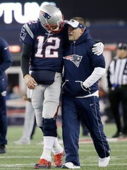 The Giants have requested permission to interview Patriots offensive coordinator Josh McDaniels, here with Tom Brady, for their head coaching vacancy.