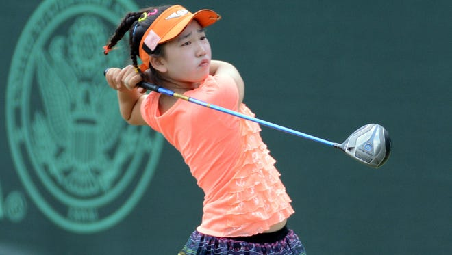 Lucy Li, 11, tees off during the Monday practice round of the U.S. Women's Open at the Pinehurst Resort and Country Club