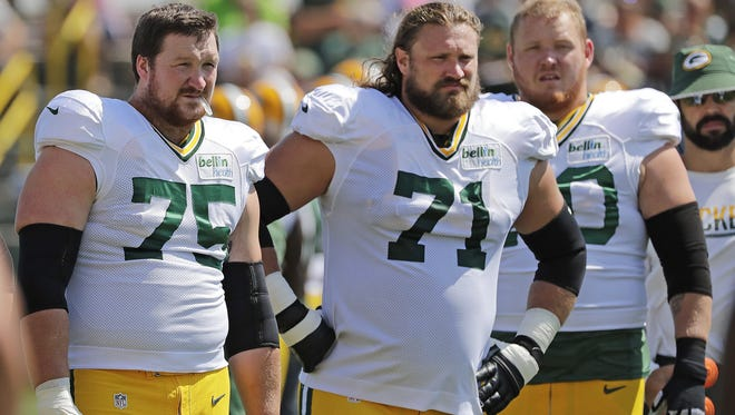 Green Bay Packers tackle Bryan Bulaga (75), guard Josh Sitton (71) and guard T.J. Lang (70) during training camp at Ray Nitschke Field August 23, 2016.