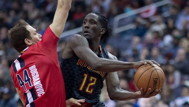 Taurean Prince of the Atlanta Hawks makes a move against Bojan Bogdanovic of the Washington Wizards in a game March 22, 2017.