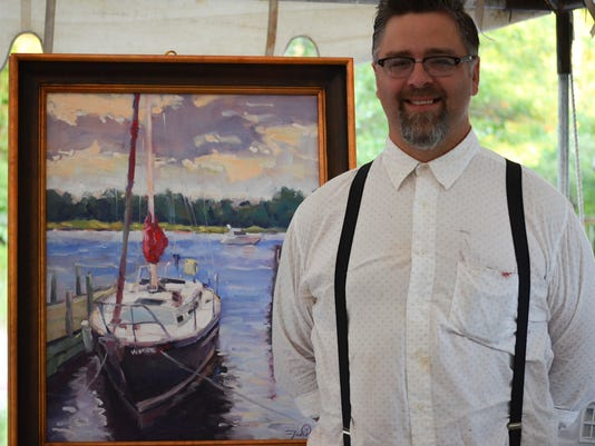 Jason Prigge and his winning piece 22x28 2.JPG