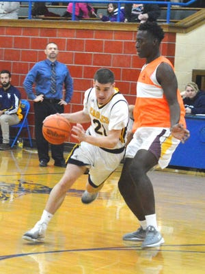 Eastern Christian junior Jared Post driving against Sinai Christian in an independent game.
