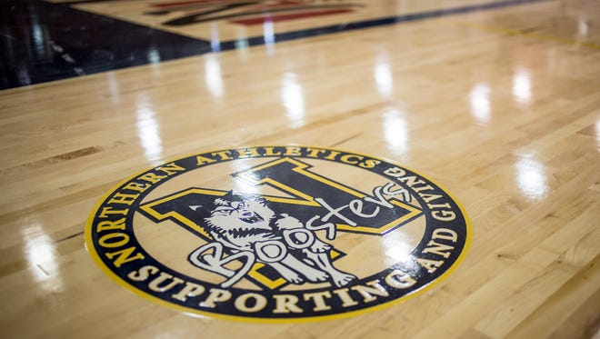 A logo for the Northern Athletic Boosters is displayed on the new gym floor at Port Huron Northern.