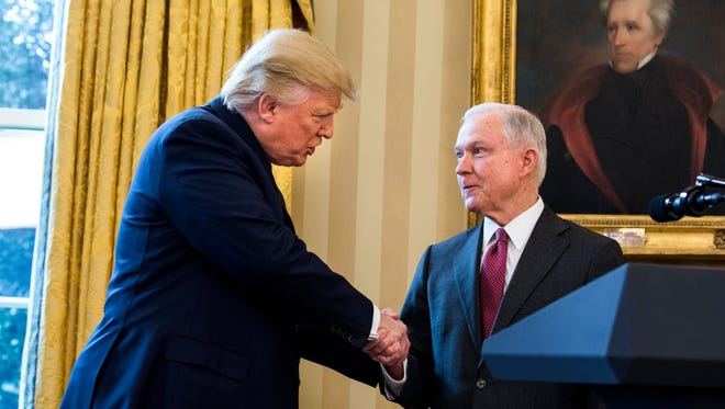 President Donald J. Trump  shakes hands with Attorney General Jeff Sessions shortly after Sessions was sworn by Vice President Mike Pence on Thursday in the Oval Office of the White House.
