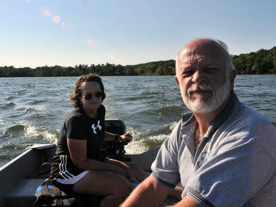 Koronis Lake Association President Karen Langmo and Kevin Farnum of the KLA traveled through the bay off the Minnesota Highway 55 public access Aug. 24 on Lake Koronis near Paynesville to the 6-acre pilot site at the spot locally known as Stonegate Point.