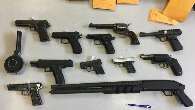 Firearms recovered by Cincinnati police from a West End home during a warranted search.
