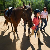 Emily Bailey, 8, rides Forest during a therapy riding lesson at Leap of Faith Farm in Simpsonville on Monday, April 19, 2016.
