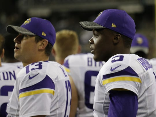 Minnesota Vikings quarterbacks Teddy Bridgewater, right, and Shaun Hill, left, stand on the sideline during the second half of a preseason game on Aug. 18 against the Seattle Seahawks in Seattle.
