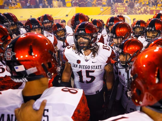 San Diego State's Nick Bawden huddles with teammates against Arizona State last season.