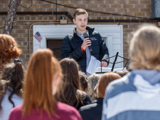 Oconomowoc High School senior Lukas Hunter speaks during a student walkout/rally to raise awareness about gun violence and school safety in downtown Oconomowoc on Friday, April 20, 2018. The date coincides with the 19th anniversary of the Columbine shooting tragedy.