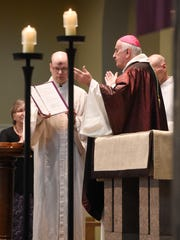 Bishop Donald Kettler completes the blessing of the