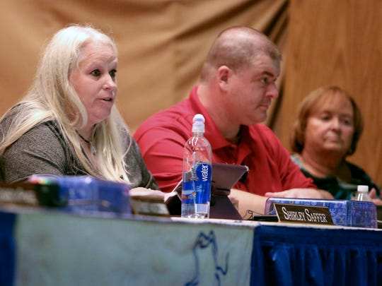 Christina school board member Shirley Saffer (left) speaks during a meeting Tuesday at Sarah Pyle Academy as fellow board members John Young and Meg Mason listen.