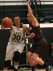 Cloudcroft's Neenah Renteria, left, dribbles past Tularosa's Gracie Hooten on Tuesday night.