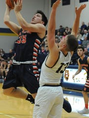 Junior guard Benito Munoz penetrates the paint Wednesday for Harrison.