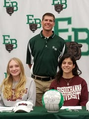 East Brunswick's Jordyn Horowitz (left) and Samantha Balsamo sign their National Letters of Intent on Tuesday with coach Christian Portera.