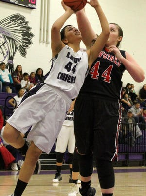 Mescalero's Lauryn Yuzos, left, puts up a shot while being fouled by Cliff's Jame Jenkins on Friday night.