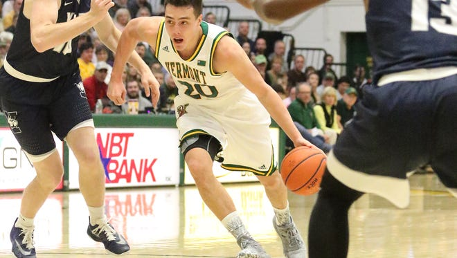 UVM Sophomore Ernie Duncan drives to the hoop during Vermont's 67-65 win over Yale.