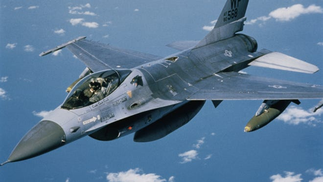 Aerial view of an F-16 in flight.