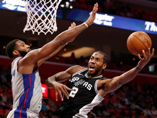 San Antonio Spurs forward Kawhi Leonard goes up for