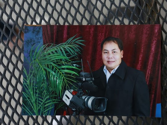 Nengmy Vang holds a video camera worth thousands of dollars. The camera was part of a dispute between him and his wife, Naly Vang, as they separated.