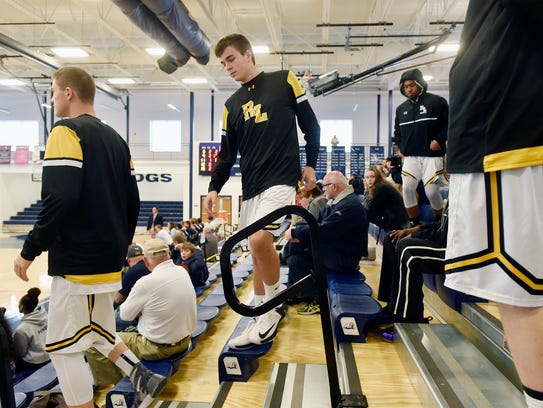 The Red Lion basketball team leaves the stands to prepare