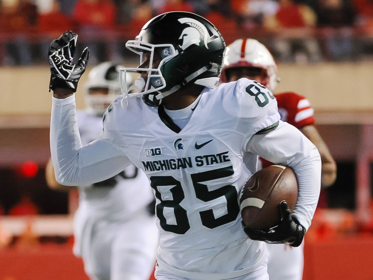 Nov 7, 2015; Lincoln, NE, USA; Michigan State Spartans wide receiver Macgarrett Kings Jr. (85) carries the ball to score a touchdown against the Nebraska Cornhuskers at Memorial Stadium.