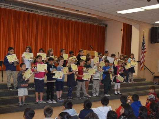 These pupils, who received a certificate of completion, participate in an adopting ceremony at Rio Vista Elementary School.