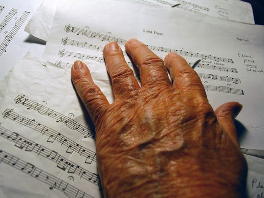 Music was a key part of George Offitt's life. Above, Offitt touches notes pages at his Gallatin home in May of 2013.