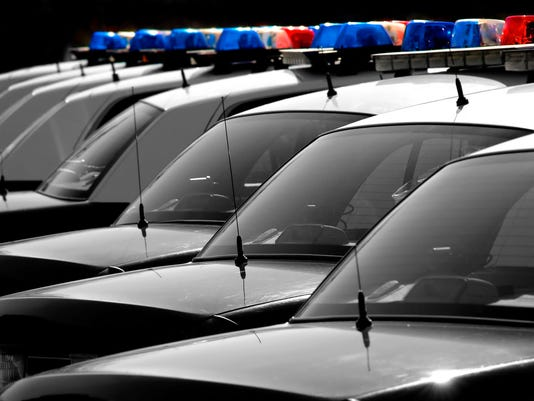 Police cars in a row on a dark background