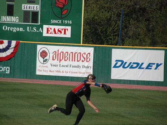 Canal center fielder Hannah Navarro makes a clutch defensive play in catching a fly ball for a put out in the fourth inning.