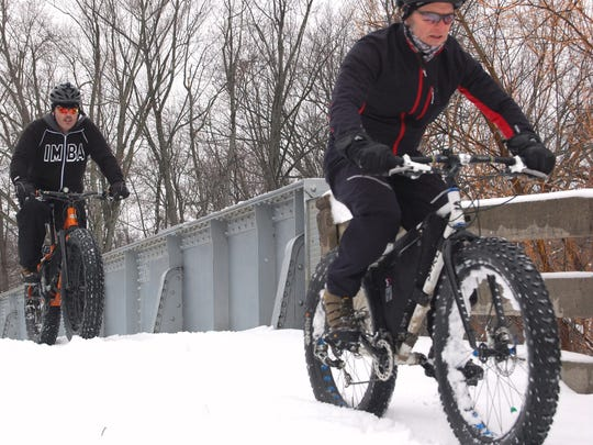 Gary Barden, front, and Bob Dunahee ride their fat bikes in Wausau. Barden, the president of the Central Wisconsin Offroad Cycling Coalition, said his New Year's wish is for more snow.