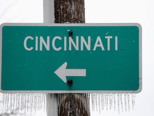 This sign gives directions in Covington to cross Ohio River from  the Roebling Suspension bridge but its closed due to ice.