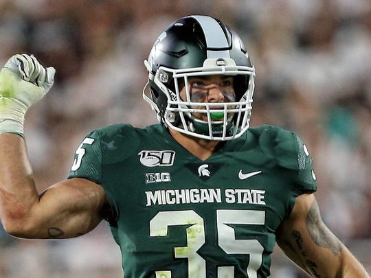 Aug 30, 2019; East Lansing, MI, USA; Michigan State Spartans linebacker Joe Bachie (35) reacts to a play during the second half of a game against the Tulsa Golden Hurricane at Spartan Stadium. Mandatory Credit: Mike Carter-USA TODAY Sports