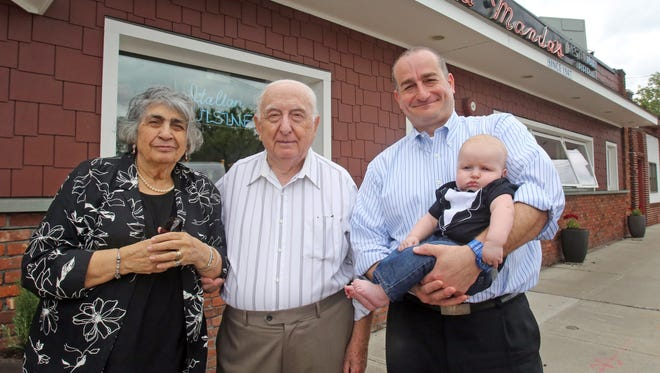 Jerry Musilli, center, his wife Maria Vita Musilli, left, and son Sly Musilli and grandson Gennaro Musilli are photographed in front of their restaurant at La Manda's restaurant.