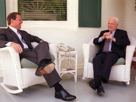 Vice President Al Gore, left, talks with Sen. John