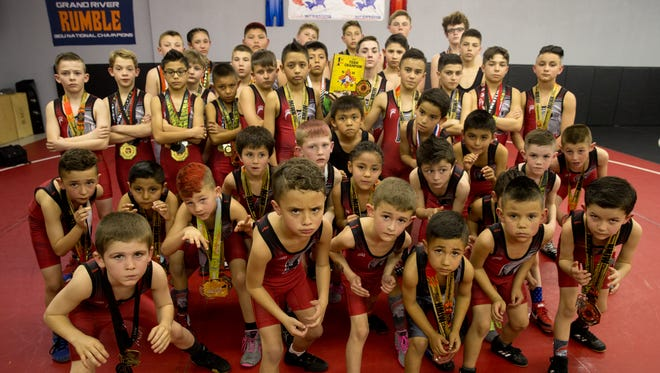 Junior wrestlers from Stout Wrestling Academy in Farmington pose for a team portrait on Wednesday.