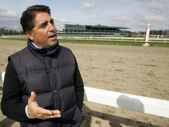 Trainer Greg Sacco speaks along the rail at Monmouth Park in this file photo from the Asbury Park Press.