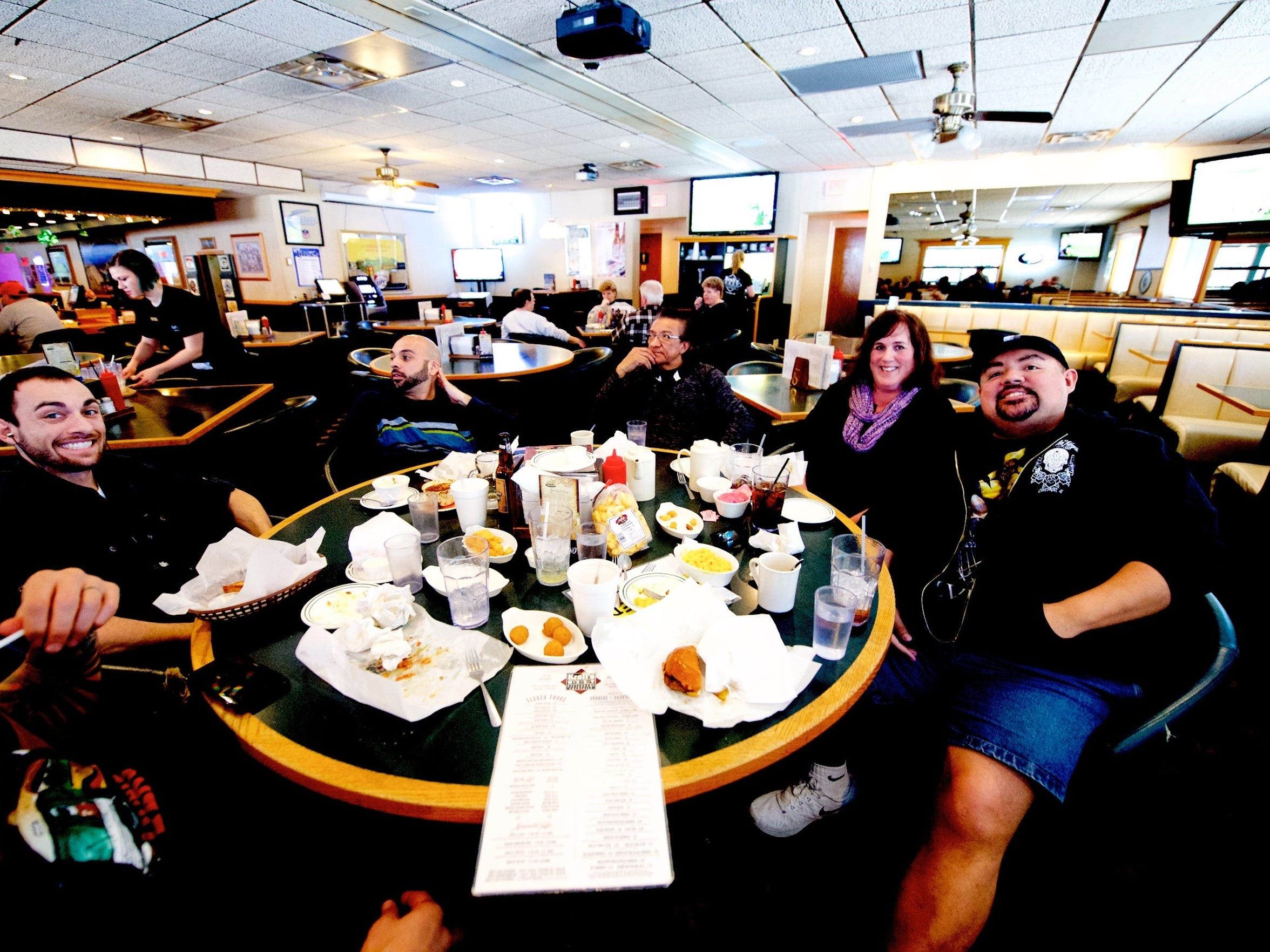Comedian Gabriel Iglesias and his crew enjoyed some down time between Weidner Center shows while having lunch together at Kroll's West.