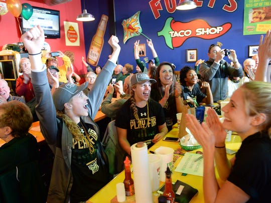The CSU women's basketball team celebrates at the NCAA tournament selection show watch party on Monday at Fuzzy's Taco Shop. The No. 11 Rams will play No. 6 South Florida.