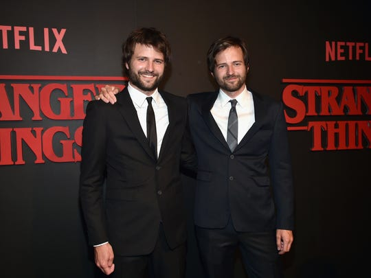 """Stranger Things"" creators Ross Duffer, left, and Matt Duffer attend the show's July 11 premiere in Los Angeles."