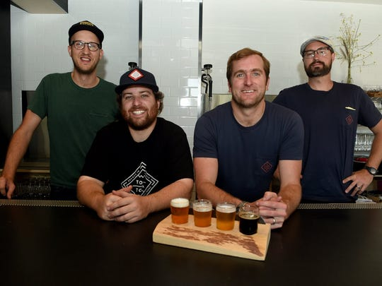 Topa Topa Brewing Co. head brewer Casey Harris, second from left, will dress as Santa during the brewery's Holiday Hootenanny on Dec. 11.