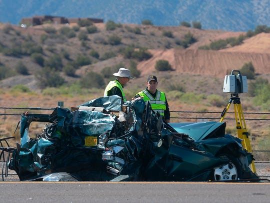 Emergency personnel work at the scene of a deadly multivehicle crash involving a bus that occurred on Interstate 25 just north of Bernalillo, N.M., on Sunday.