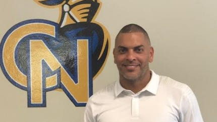 Cardinal Newman has hired Andre Torres as its new athletic director.